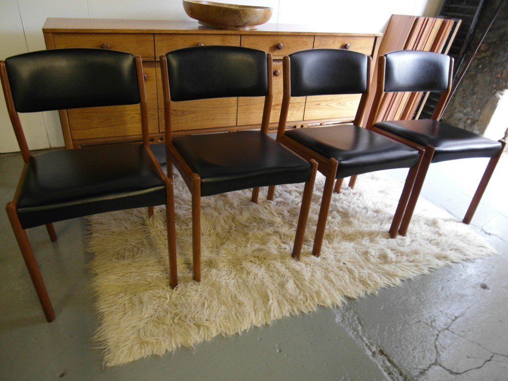 Set of Four Danish Chairs by Stoodart in Solid Teak and Black vinyl £150