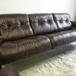 Jean Gillon Leather and Rosewood Sofa sold